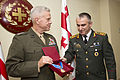 Commandant of the U.S. Marine Corps, Gen. James F. Amos receives an award at Tbilisi, Georgia, Sept. 4, 2014..JPG