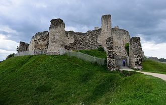 Conisbrough Castle - The inner bailey seen from the outer bailey, showing the remains of the barbican and the mural towers