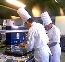 Trainee cooks preparing food