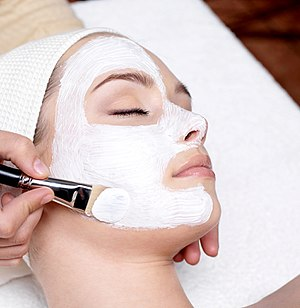 Skin care - A cosmetologist applying a face mask