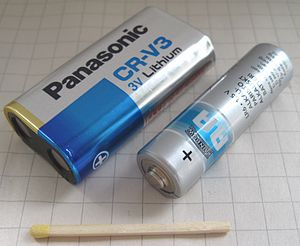 CR-V3 battery - A CR-V3 battery with matchstick and AA battery for comparison.
