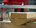 Cutting lumber with a swingblade sawmill-2.jpg