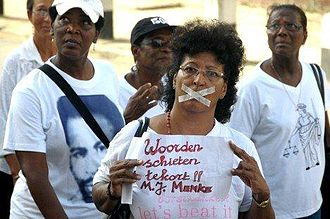 Dési Bouterse - Thousands of people in Paramaribo conduct a silent march on April 10, 2012 against the amnesty law