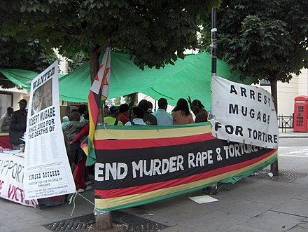 Example of foreign criticism: a demonstration against Mugabe's regime next to the Zimbabwe embassy in London (mid-2006). Demonstration against Mugabe.JPG