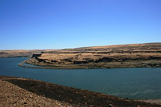 Wishram, Washington - Extensive erosion is visible across the river from Wishram near the mouth of the Deschutes River. Note the interstate highway along the far side of the river.