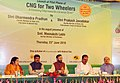 Dharmendra Pradhan and the Minister of State for Environment, Forest and Climate Change (Independent Charge), Shri Prakash Javadekar and other dignitaries at the launch of the Pilot Phase of CNG for Two Wheelers.jpg