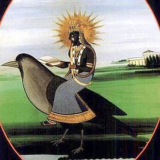 Dhumavati - An early 20th century Rajput painting depicting dark-complexioned Dhumavati wearing dark clothes and holding a winnowing basket. She is riding a crow but adorned with jewellery, decorations which are contrary to her traditional description