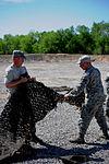 Dirty Details, Airmen demilitarize camouflage netting 140509-F-KA381-004.jpg