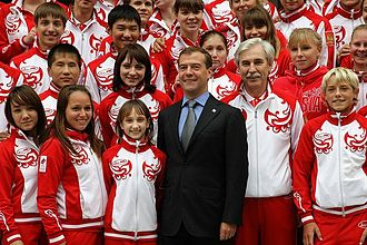 Viktoria Komova - Komova with President Dmitry Medvedev and medalists of the Russian team that participated in the 2010 Summer Youth Olympics on 30 August 2010.