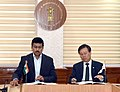 Do Jong-hwan signing an MoU on sports cooperation between the two nations, in New Delhi.JPG