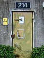 Door with explosives warnings at a disused military airfield (51260173113).jpg