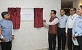 Dr. Hasmukh Adhia, IAS unveiling the plaque to inaugurate the New GST Council Office.jpg