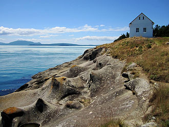 Saturna Island - East Point Fog Alarm Building and Sandstone formations.