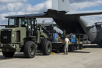 United States Transportation Command - A West Virginia Air National Guard C-130 Hercules prepares to offload cargo at Camp Shelby Joint Forces Training Center, Miss., during Exercise Turbo Distribution, Oct. 28, 2015. TD is a joint-funded series of U.S. Transportation Command Field Training Exercises to train Joint Task Force - Port Opening Aerial Port Debarkation and Seaport of Debarkation capabilities. (U.S. Air Force photo by Staff Sgt. Kenneth W. Norman/Released)