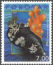 A stamp from the Faroe Islands showing Modiolus modiolus, the horse mussel, with various other marine invertebrates living on its shell.