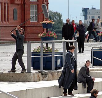 "A number of BBC productions, such as Doctor Who and Torchwood, have been filmed in Wales. Filming ""Torchwood"" in Cardiff (2).jpg"