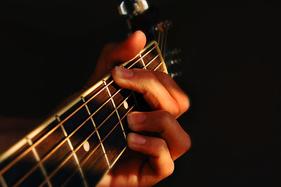 Fingers playing guitar.jpg