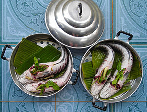 Channa striata - Snakehead fish packed with lemon grass and lime leaves ready for steaming