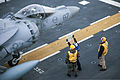 Flight deck crewmen use a status board to provide information to the pilot of an AV-8B Harrier as he prepares to takeoff from the flight deck of the USS Bataan (LHD 5) during flight operations in the Atlantic O 121215-M-SO289-020.jpg