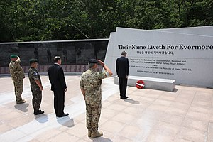 Gloucester Valley Battle Monument - British soldiers and officials pay respects at memorial wall