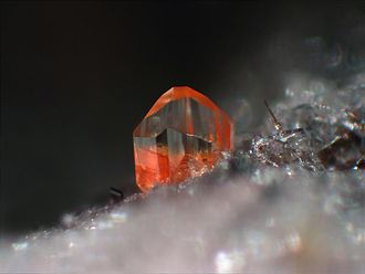 Forsterite - Orange forsterite with a portion of tephroite