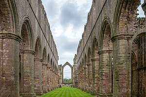 Fountains Abbey - Interior of the abbey church looking down the nave