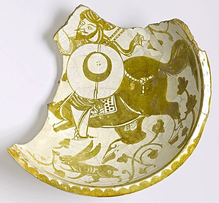 Fragment of a bowl depicting a mounted warrior, 11th century. Fatimid dynasty, found in Fustat, Egypt. Brooklyn Museum Fragment of a Bowl Depicting a Mounted Warrior, 11th century. 86.227.83.jpg