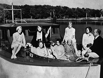 Huckins Yacht Corporation - Maiden voyage of the Fairform Flyer. Frank Huckins, founder of Huckins Yacht Corporation, is seated on the right with a pipe.