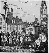 A population celebrates while soldiers escort a secured wagon of material through the city. A pair of twin spires tower above the city, indicating the city is Zurich, Switzerland.