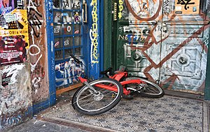 Vandalism - A damaged bicycle at a house entrance which was vandalised with spray paint in Hamburg