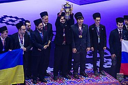 GM Sam Shankland raises the Golden cup for the US team (29638496672).jpg