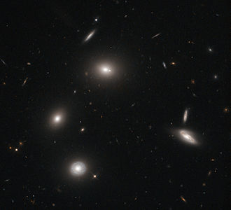 Elliptical galaxy - The central galaxy in this image is a gigantic elliptical galaxy designated 4C 73.08.
