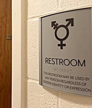 "This is a picture of sign with a circle transgender symbol, captioned ""Restroom"" and braile for ""Restroom"", and ""This restroom may be used by any person regardless of the gender identity or expression"""