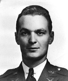 Photograph of a man's head and shoulders. The man is looking directly at the camera. He is wearing a military uniform.