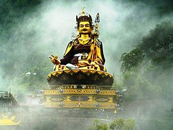 Statue of Padmasambhava 123 ft. (37.5 m) high in mist overlooking Rewalsar Lake, Himachal Pradesh, India.