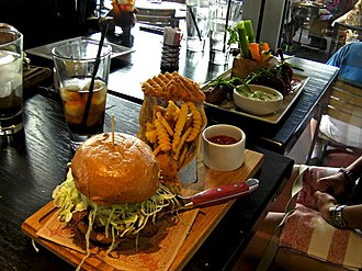 Guy Fieri - Image: Guy Fieri's Vegas Kitchen & Bar burger and wings