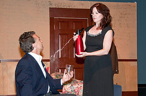 Don't Dress for Dinner - Jacqueline (Tina Segovia) splashes Bernard (Joe Kelly) with soda in the 2009 Potomac Theatre Company production of the play.