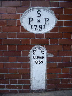 Boundary stone between St Pancras and Hornsey at Highgate Haringay Camden boundary.jpg