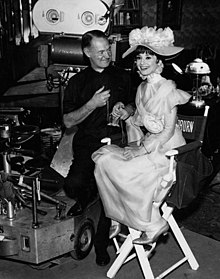 my fair lady film cinematographer harry stradling poses audrey hepburn as eliza doolittle on the set of the film