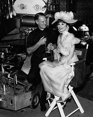 My Fair Lady (film) - Cinematographer Harry Stradling poses with Audrey Hepburn as Eliza Doolittle on the set of the film