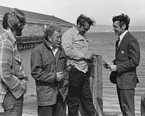Harvey Milk - By the time of Milk's 1975 campaign, he had decided to cut his hair and wear suits. Here, Milk (far right) is campaigning with longshoremen in San Francisco during his 1976 race for the California State Assembly.