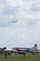 Heritage Flight Boeing C-17A Globemaster III de Havilland CV-2B Caribou 62-4149 Over Flightline SNF 16April2010 (14443746990).jpg