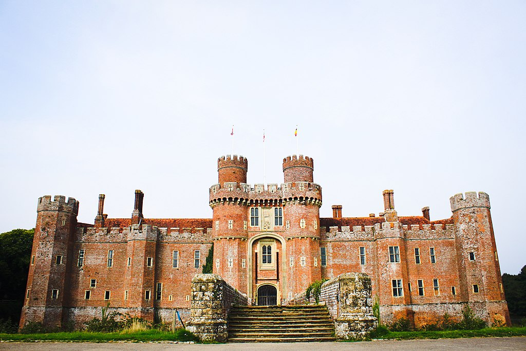 Herstmonceux Castle made from brick with a bridge leading to entrance