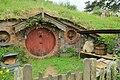 Hobbit hole with brown door 1.jpg