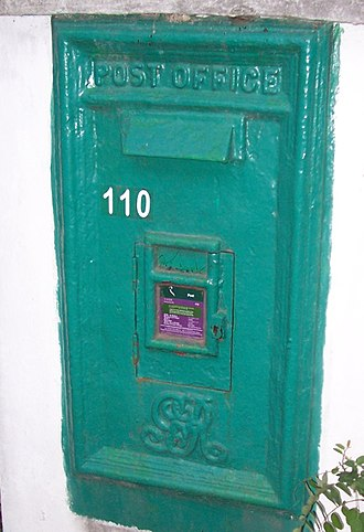 Hongkong Post - HongKong Post box bearing insignia of King George V, made during the colonial era, but painted in green from red after 1997