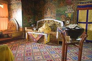 Potala Palace - The former quarters of the Dalai Lama. The figure in the throne represents Tenzin Gyatso, the incumbent Dalai Lama