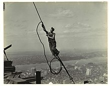 A photograph of a cable worker, taken by Lewis Hine as part of his project to document the Empire State Building's construction