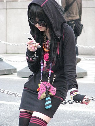 Japanese mobile phone culture - A girl in the Harajuku district of Tokyo with a phone, 2008
