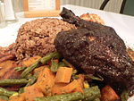Jerk chicken with rice and plantains