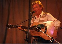 Jim Rooney, bluegrass musician on stage at Cambridge Folk Festival, 1985.jpg